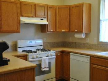 There is a shared kitchen for guest use at the Inn's Guest House.