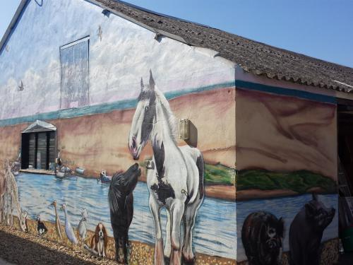 A mural of our pets painted on the barn