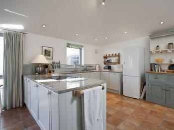 The large island and amply kitted out kitchen