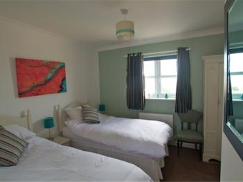 Twin bedroom with en suite shower room and sea views