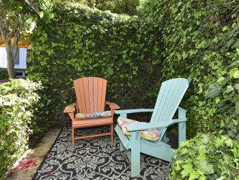 Emerge from the Tuscany Carriage House and enjoy the garden