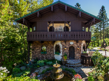 Storybook Riverside Inn - Storybook Riverside Inn front entrance with cottage garden and cascading fountain.