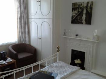 Guest room with original Victorian fireplace.