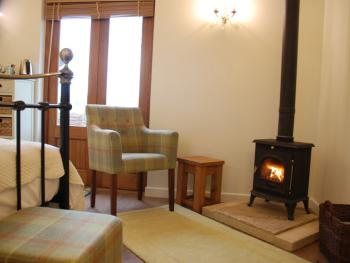 Barlake Lodge has its own log burner in this cosy room with outlooks onto open fields