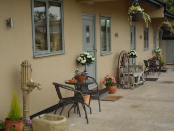 The Stables - Deer Park Farm - An outside terrace of one of the chalets