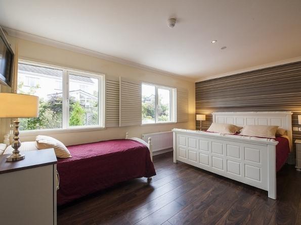 Triple room ensuite, rain shower, bath, garden view.