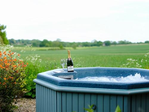 Relax in a bubbling hot tub in your own Secret Garden taking in the views over open fields. (Canterbury suite only)
