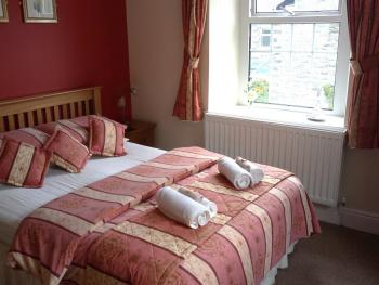 room 6  with double bed and adjoining single room sleeps three,, with ensuite ( can be used has a double room..for two persons )