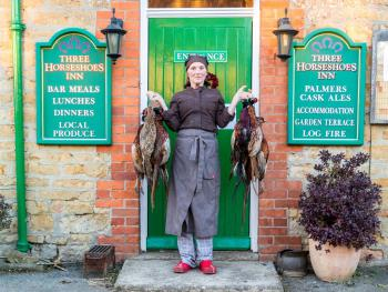 Amie with locally shot pheasants for the menu