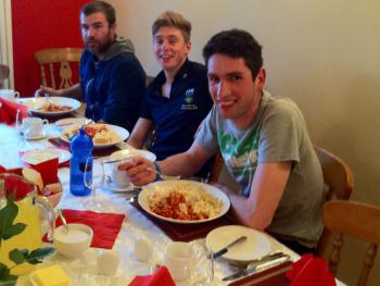 Cyclists enjoying relaxing dinner after Tour of Ulster