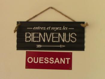 affiche sur la porte de l'appartement Ouessant