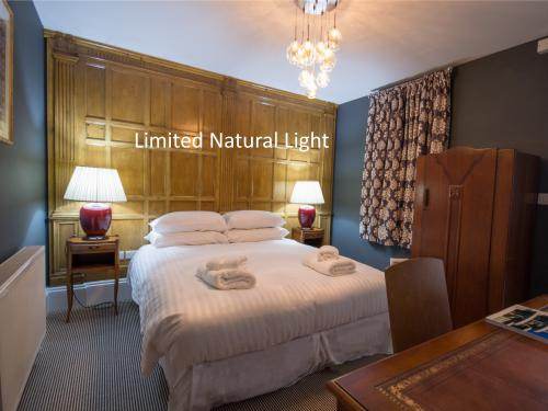 Room 6 - No View, Reduced Natural Light, comfortable king size bed and ensuite bathroom