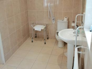 Disabled access bathroom - walk-in shower, no bath, grab rails