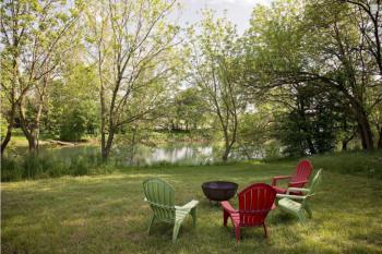 Relax around the fire pit next ro the river.