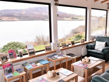 Guest lounge overlooking Loch Portree and our gardens.  The perfect place for seal, otter, and sea-eagle spotting after breakfast.
