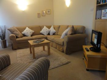 Spacious living room with panoramic window - exchange library. TV/DVD (Freeview). Free WiFi and parking.
