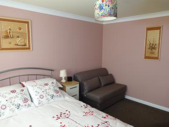 Bedroom 5 with sofa