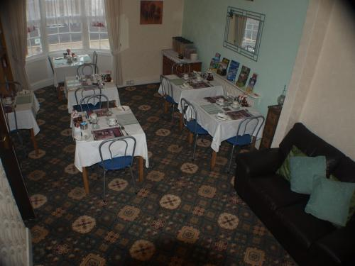 Our dining room is set up for your comfort with a table for each bedroom.