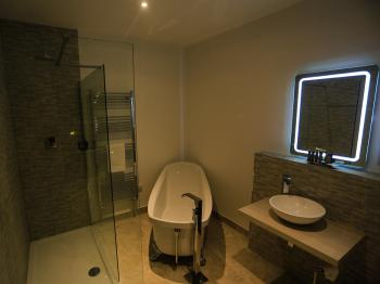 """Hartland"" bathroom complete with slipper bath and double walk in shower"