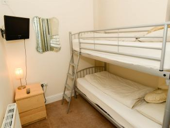 Adjoining room to family suite with full sized bunk beds and a sea view