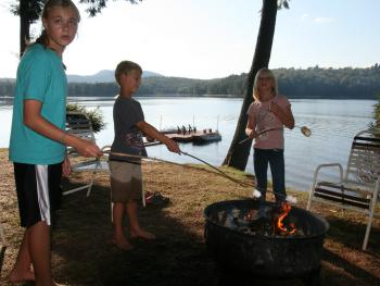 Roasting smores outside Journey's End Lake House