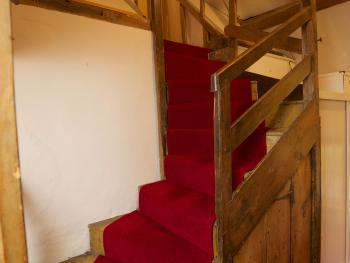 Up winding stairs to Pretty attic room