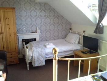 Single bed in our triple room with Smart TV
