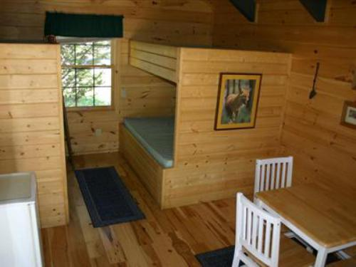 The cabins 6-10 have 2 double beds and 2 single beds and will sleep up to 6. These cabins also have a table and chairs inside along with the small refridgerator. The extra room makes the winter stays