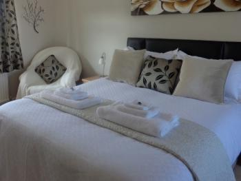 Potters House - Double room with king size bed.