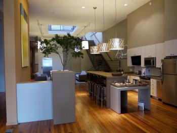 View of Lobby Desk + Kitchen Area with Breakfast Bar