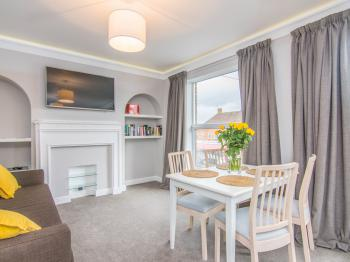 Fab Apartment - Large lounge with two double sofa beds