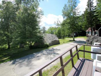 View of boulders and trees from deck of Cottage #9