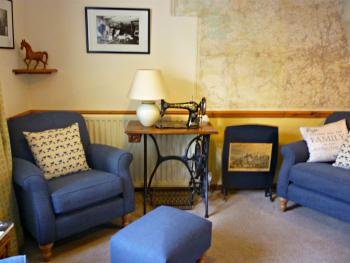 B&B lounge with large scale local map on wall