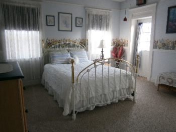 Ciara room, located on the bright southeast corner with a brass queen size bed, and private bath.