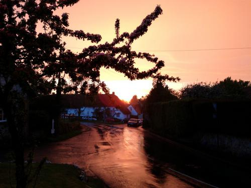 A view of Ashbury village at sunset from the front of the pub