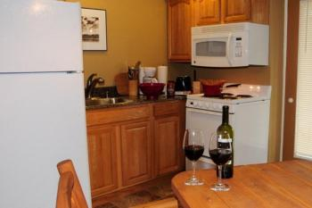 """small kitchen with full-size appliances in our 1-Bedroom Kitchen Suites- """"Hudson"""" and """"Chatimac"""""""