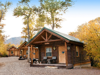 Cabins are all the same except decor.  Two queen beds (one private room) other in main room with kitchenette, Dining Area, TV, Heat and A/C.  Outside: Private Porch, Propane BBQ, Picnic Table.