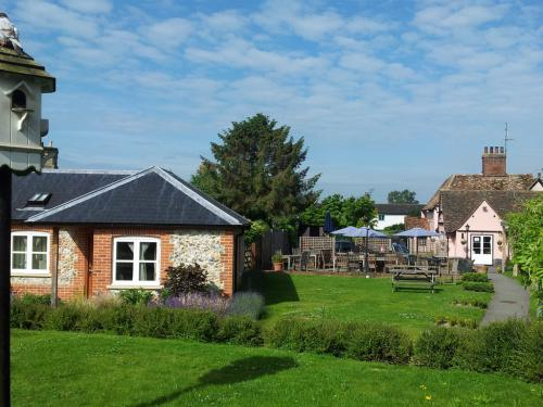 Dovecote, guest rooms, garden and pub