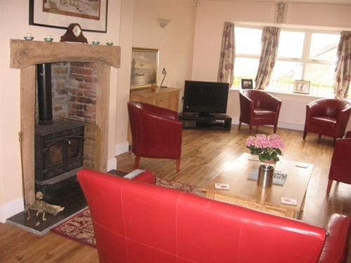 Relax in our beautiful guest lounge and enjoy the view or on a cold day our log fire.