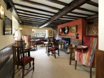 Our snug is perfect for a relaxing drink with friends or can be set up for private dining