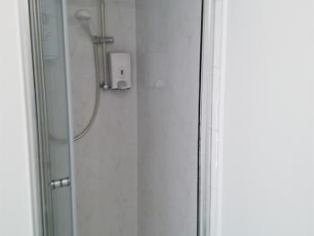 Separate shower on second floor outside rooms 3 and 4