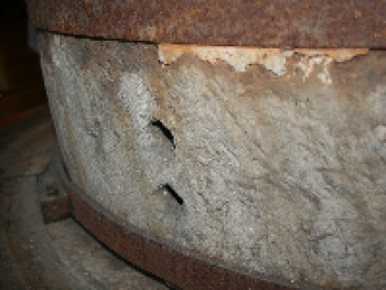 The grist mill where grits and cornmeal were ground is still intact.  The running stone, weighs approximately 2,000 lbs and rotates counterclockwise over the stationary stone.
