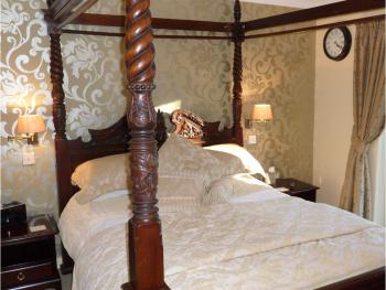 The Luxury Room, King size mahogany, luxury shower room, with fridge, Digital TV/DVD, Tea & Coffee making Facilities.