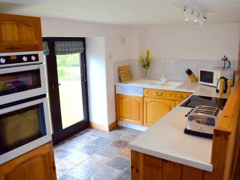 The Kitchen area in Wistaria Cottage