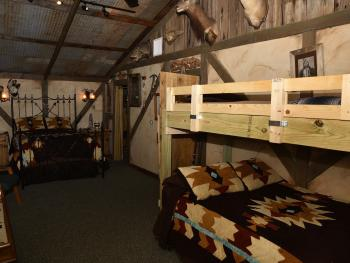 Bunkhouse Indian bedroom with two queen beds and twin bunk bed