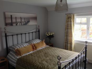 Laura Contemporary Room with Brass Bed