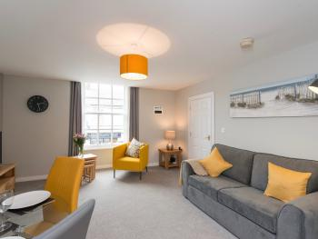 Hamilton House Holiday Apartment - Cosy living area with dining.