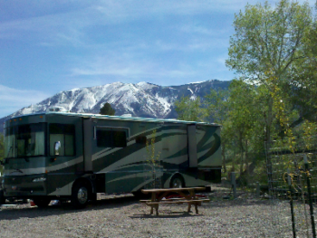 Extra wide back in RV sites with full hookups.  30/50 amp, sewer, water, picnic table, afternoon shade and spectacular view of the Monroe Mountains.  Only 3 sites!