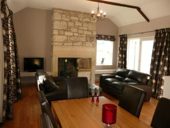 The spacious open plan living and dinning room of Groom's Cottage