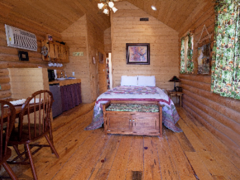 Main room of the cabin has a queen bed; kitchenette area; Dining area; Heat and A/C; TV.  Only different inside is decor.  All towels and linens provided.